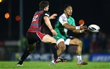 Connacht centre Bundee Aki gets his pass away under pressure from Edinburgh's Sam Beard Credit: ©INPHO/James Crombie
