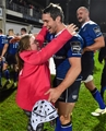 Leinster scrum half Isaac Boss gets a post-match hug from Tara McDermott, daughter of Leinster Branch President Robert McDermott Credit: ©SPORTSFILE/Ramsey Cardy