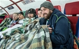 Second row Aly Muldowney and his team-mates use blankets to stay warm as they watch the conclusion of the game Credit: ©INPHO/James Crombie