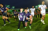 Connacht captain Tiernan O'Halloran poses with the province's mascot Daniel Tynan Credit: ©INPHO/James Crombie