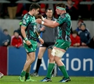 Tiernan O'Halloran celebrates his 17th minute try with Connacht number 8 Eoghan Masterson Credit: ©INPHO/Dan Sheridan