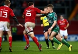 Connacht's Matt Healy feels the force of a hand-off from Munster captain CJ Stander Credit: ©INPHO/James Crombie