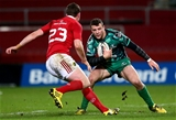 Robbie Henshaw tries to wrong-foot Munster replacement Denis Hurley as Connacht press for another score Credit: ©INPHO/James Crombie