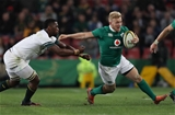 Centre Stuart Olding, who made his first start since his debut in June 2013, hands off South African flanker Siya Kolisi Credit: ©INPHO/Billy Stickland