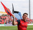 Ian Keatley waves the flags of Shannon RFC, Anthony Foley's club, and Munster after the game Credit: ©INPHO/Ryan Byrne