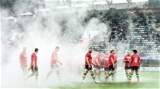 Jamie Heaslip and his Leinster team-mates make their way through the smoke, wearing red T-shirts in memory of late Munster head coach Anthony Foley Credit: ©SPORTSFILE/Stephen McCarthy