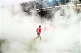 Replacement out-half Joey Carbery emerges through the smoke as the Leinster players take to the pitch for the lunchtime kick-off Credit: ©SPORTSFILE/Stephen McCarthy