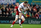 Munster winger Ronan O'Mahony gets a tackle in on Craig Gilroy, one of the Ulster players included in the Ireland squad for their Chicago game against New Zealand Credit: ©INPHO/Dan Sheridan