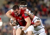 Munster flanker Tommy O'Donnell makes a carry under pressure from Ulster front rowers Wiehahn Herbst and Rob Herring Credit: ©INPHO/Dan Sheridan