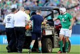 Ireland captain Rory Best commiserates with the injured Jordi Murphy as he is stretchered off Credit: ©INPHO/Dan Sheridan
