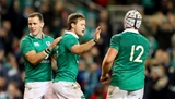 Scrum half Kieran Marmion, the scorer of Ireland's sixth try, is congratulated by Craig Gilroy and Luke Marshall Credit: ©INPHO/James Crombie