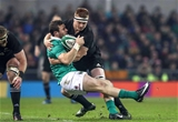 Ireland centre Robbie Henshaw is injured in a tackle from New Zealand's Sam Cane Credit: ©INPHO/Billy Stickland