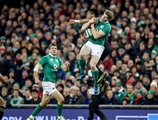 Ireland winger Andrew Trimble gets to a high ball ahead of New Zealand's Julian Savea Credit: ©INPHO/Billy Stickland