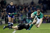 Andrew Trimble does really well to keep himself in the field of play, under pressure from New Zealand full-back Ben Smith Credit: ©INPHO/Dan Sheridan