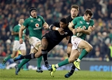 Jared Payne is tackled by New Zealand's Waisake Naholo and Beauden Barrett during a late Ireland attack Credit: ©INPHO/Dan Sheridan
