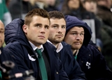CJ Stander and Robbie Henshaw, who were both injured during the first half, and Jack McGrath watch the final minutes' action from the bench Credit: ©INPHO/Billy Stickland
