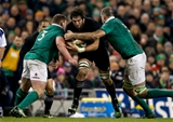 New Zealand second row Sam Whitelock clatters into tackles from Tadhg Furlong and Devin Toner Credit: ©INPHO/Tommy Dickson
