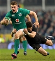 Garry Ringrose, who won his second successive Ireland caps, is tackled by New Zealand number 10 Beauden Barrett Credit: ©INPHO/James Crombie