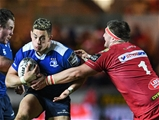Scarlets prop Wyn Jones reaches out to tackle Leinster's Noel Reid Credit: ©INPHO/Craig Thomas