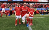 Munster captain Tommy O'Donnell are pictured with the province's two mascots Credit: ©INPHO/Donall Farmer