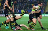 Robbie Henshaw crashes into tackles from Northampton backs JJ Hanrahan and Nic Groom Credit: ©INPHO/James Crombie