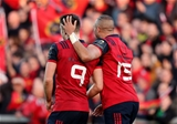 Simon Zebo thanks Conor Murray for his assist which sent the full-back slicing through and in behind the posts Credit: ©INPHO/Dan Sheridan