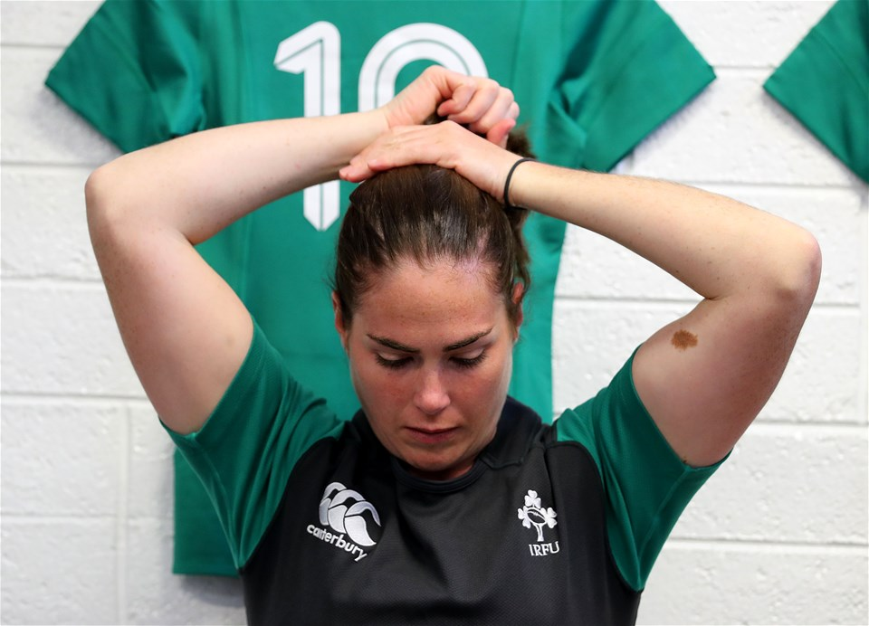 Out-half Nora Stapleton ties up her hair as the Ireland Women make their final preparations for the opening Pool C clash with Australia