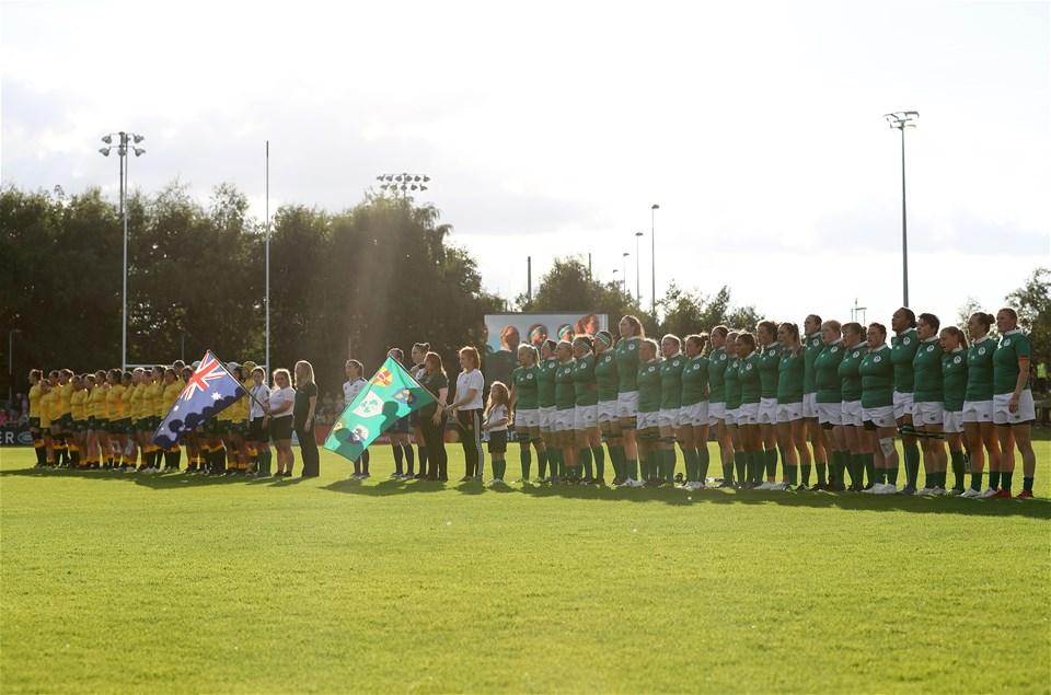 The Australia and Ireland teams stand for the anthems at the UCD Bowl