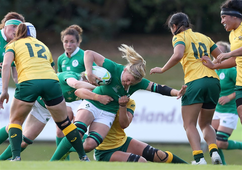 Ireland's openside flanker and captain Claire Molloy drives forward, under pressure from Australian back rower Mollie Gray