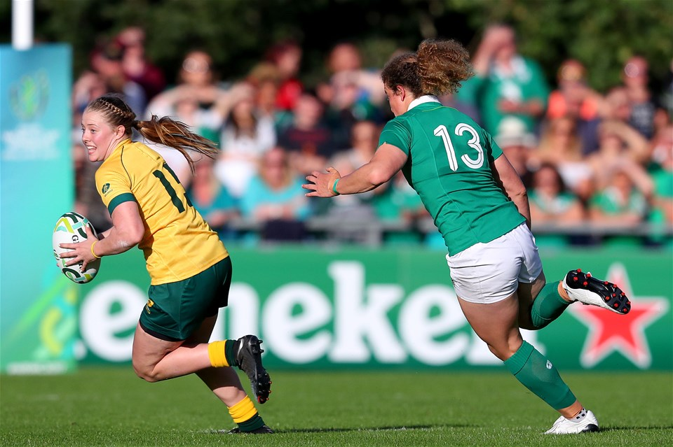 Ireland's tough-tackling centre Jenny Murphy chases Samantha Treherne of Australia during the opening minutes of the match
