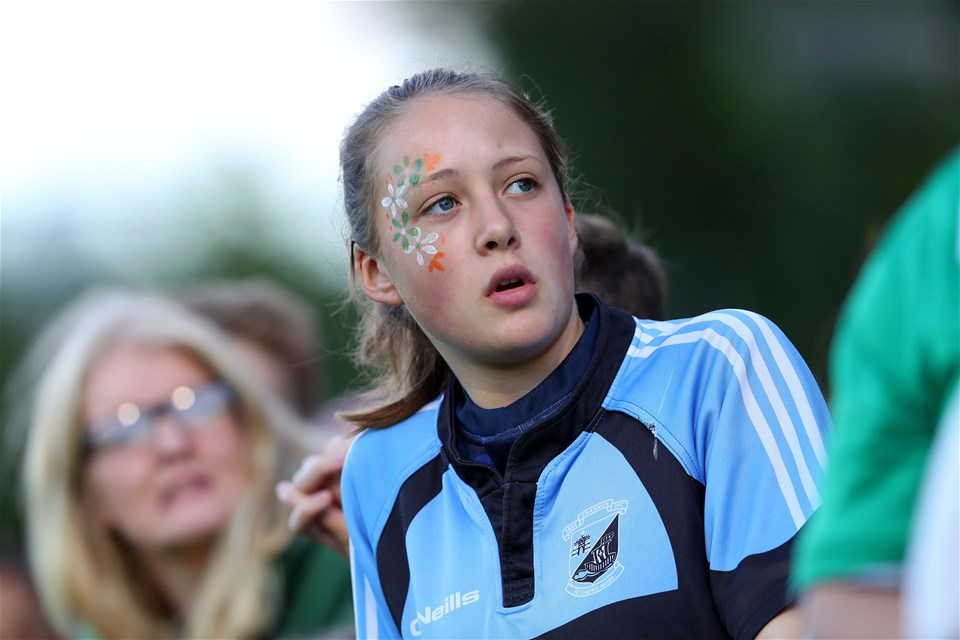 Young Ireland fan Cara Burns watches a replay on the screen during the first half