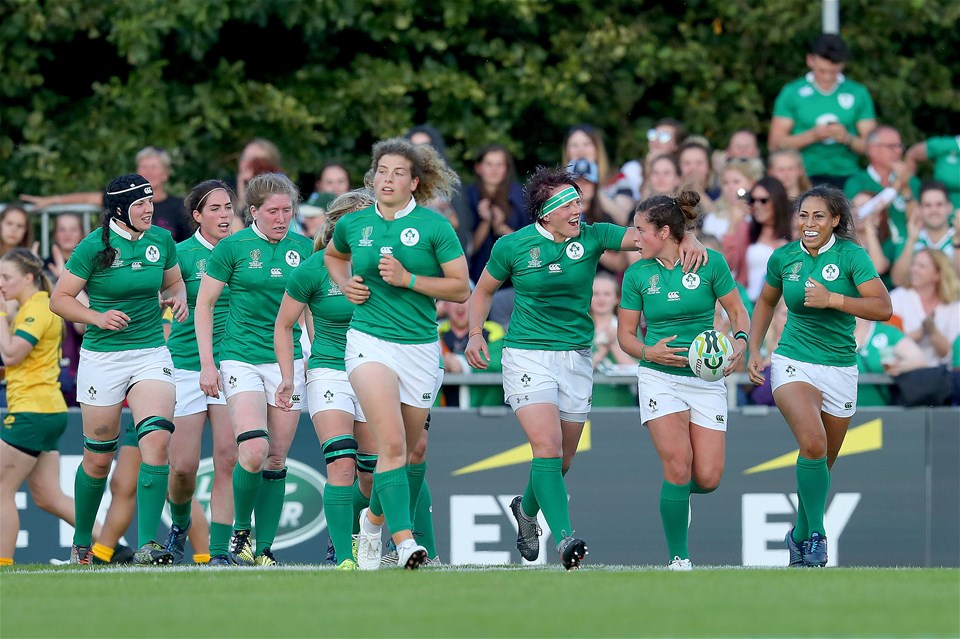 Prop Lindsay Peat puts her arm around try scorer Larissa Muldoon as Ireland hit the front against the Australians
