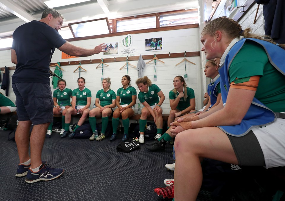 Ireland head coach Tom Tierney passes on instructions to the backs at half-time, with his side holding a slender 7-5 lead