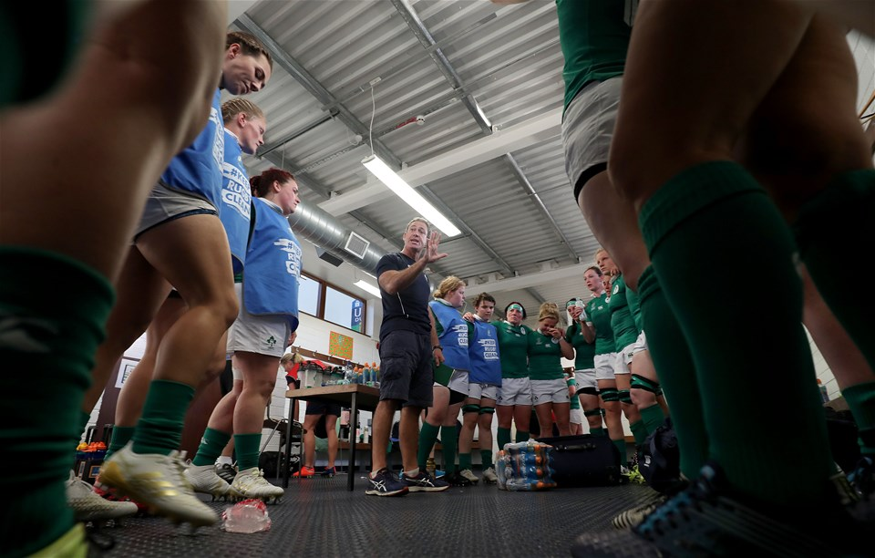 Former international scrum half Tom Tierney gives a team talk before his charges head back out for the second half against Australia