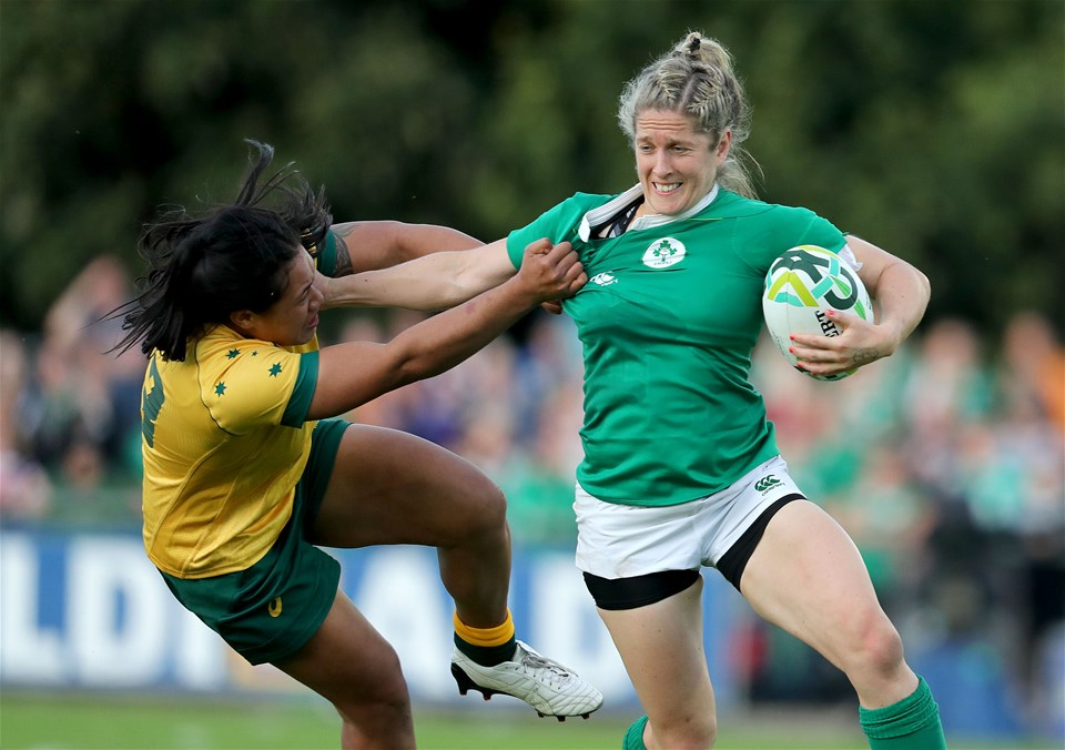 Ireland's work-hungry winger Alison tries to hand off Australian centre Kayla Sauvao