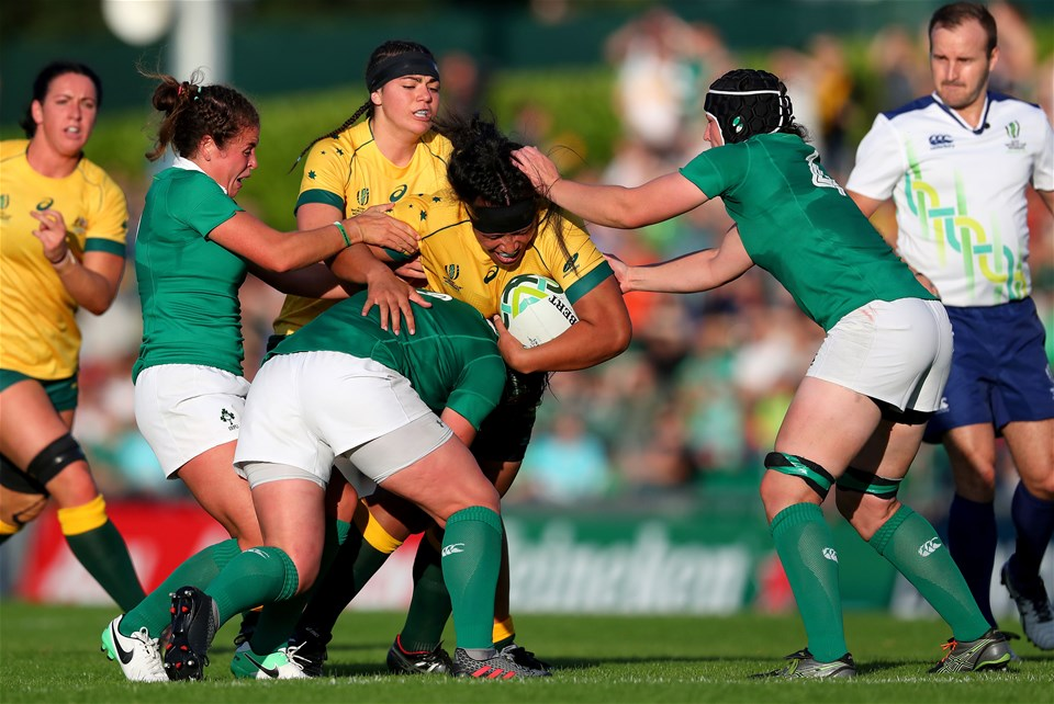 Loosehead Lindsay Peat, who was making her World Cup debut for Ireland, gets a tackle in on Australian prop Hilisha Samoa