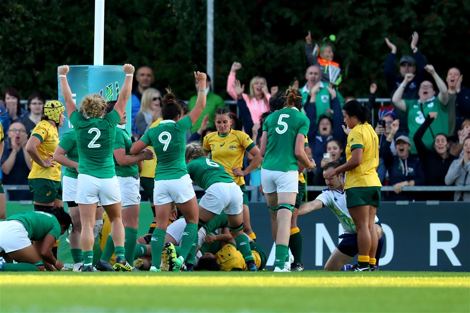 The Ireland players celebrate Ciara Griffin's try as they cancel out an earlier effort from Australian captain Shannon Parry