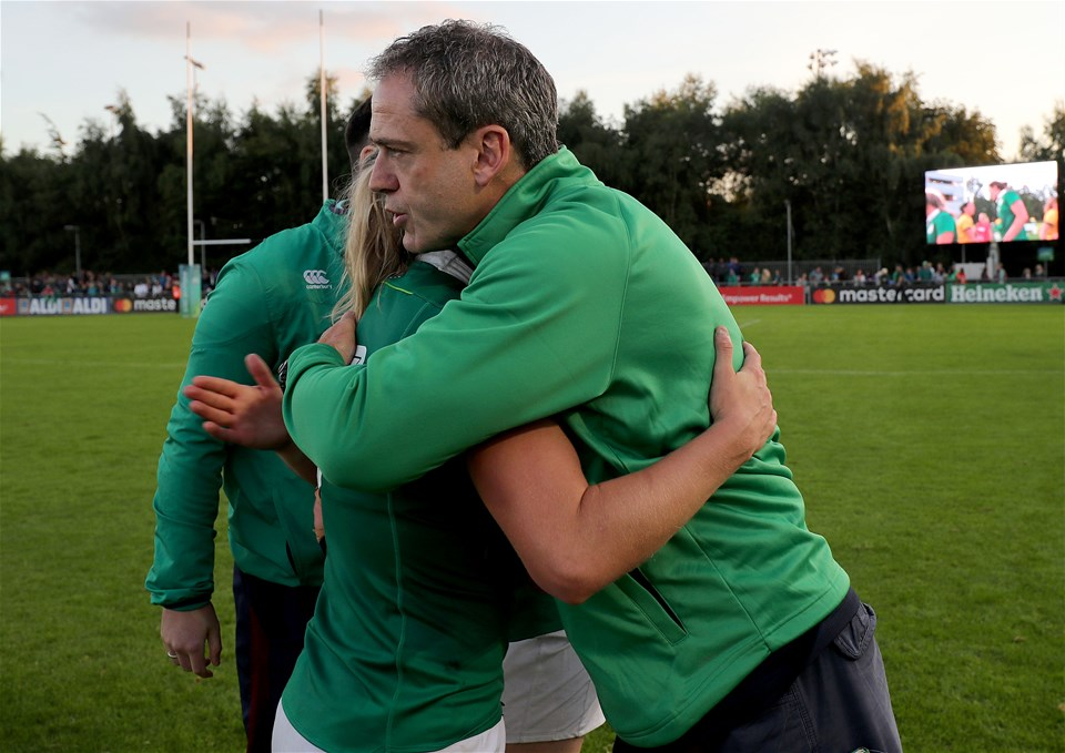 Ireland head coach Tom Tierney hugs captain Claire Molloy after the girls in green edged out Australia in a tense finish, winning 19-17