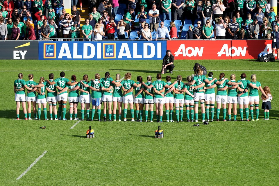 The Ireland players, led by newly-appointed captain Claire Molloy, stand together at anthem time