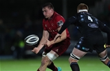 Munster flanker Tommy O'Donnell gets his pass away under pressure from Glasgow's Rob Harley Credit: ©INPHO/Billy Stickland