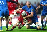 Devin Toner, one of Leinster's returning internationals, brings down Scarlets second row Jake Ball Credit: ©INPHO/James Crombie