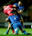 Jack Conan and Leinster skipper Rhys Ruddock combine to tackle Kieron Fonotia, one of the Scarlets' new signings Credit: ©INPHO/James Crombie