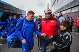 Returning Leinster prop Tadhg Furlong signs a young Scarlets fan's boots as the reigning GUINNESS PRO14 champions arrive at Parc y Scarlets Credit: ©SPORTSFILE/Stephen McCarthy