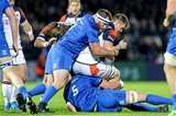Number 8 Magnus Bradbury, who scored Edinburgh's lone try, is tackled by Leinster forwards Michael Bent and James Ryan Credit: ©INPHO/Laszlo Geczo